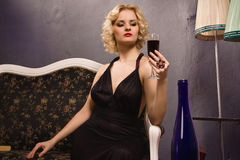 Sensual blonde in the vintage interior Royalty Free Stock Photography