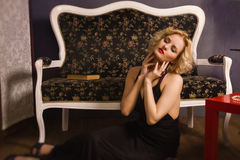 Sensual blonde in the vintage interior Royalty Free Stock Image
