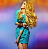 Sensual blonde wearing blue dress Stock Photography
