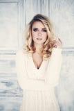 Sensual Blonde Woman. Beautiful Girl. Blonde Curly Hair Stock Photo