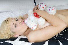 Sensual blonde woman on a bed Royalty Free Stock Images
