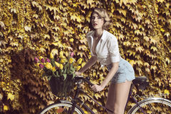 Sensual blonde woman on bicycle Royalty Free Stock Photo