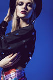 Sensual blonde woman in black hat and black top Royalty Free Stock Photos