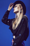 Sensual blonde woman in black top and black hat Royalty Free Stock Image