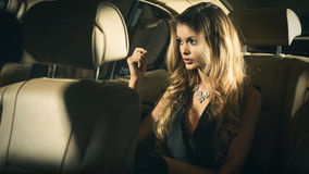 Sensual blonde woman in car Royalty Free Stock Photos