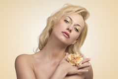 Sensual blonde woman with flower Royalty Free Stock Photos