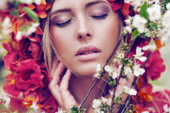 Sensual blonde woman with flowers royalty free stock photography
