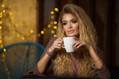 Sensual blonde woman with long curly hair royalty free stock photos