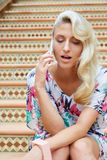 Sensual blonde woman with a phone Royalty Free Stock Photo