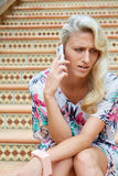 Sensual blonde woman with a phone Stock Photography