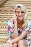Sensual blonde woman with a phone Royalty Free Stock Photography