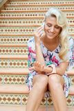 Sensual blonde woman with a phone Stock Photo