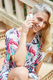 Sensual blonde woman with a phone Stock Images