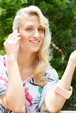 Sensual blonde woman with a phone Royalty Free Stock Image