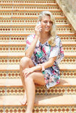 Sensual blonde woman with a phone Stock Image