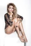 Sensual blonde woman posing Stock Images