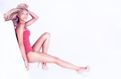 Sensual blonde woman posing in studio Stock Images