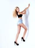 Sensual blonde woman posing in studio Royalty Free Stock Images