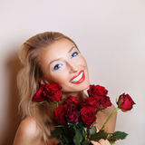 Sensual blonde woman with roses. Royalty Free Stock Image