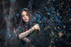 Sensual boho girl with eyes closed posing on nature. Background stock photos