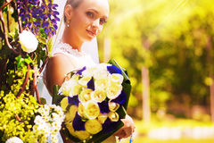 Sensual bride with bouquet of roses Royalty Free Stock Photo