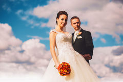 Sensual bride and groom and clouds Stock Photography
