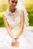 Sensual bride sitting on meadow Stock Images