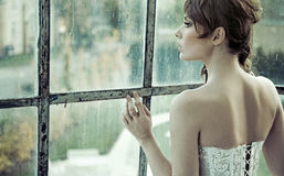 Sensual bride waiting for her husband Royalty Free Stock Images