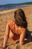 Sensual brunette on a beach Royalty Free Stock Photo