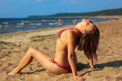 Sensual brunette woman in bikini on beach Royalty Free Stock Images
