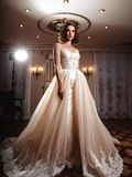 Sensual brunette bride in luxury wedding dress over classic interior Royalty Free Stock Images