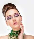 Sensual Brunette with Bright Purple Eye Make-up and Jewelry. Glamor Stock Photo