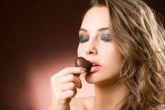 Sensual brunette chocolate girl. Royalty Free Stock Images