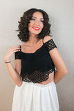 Sensual brunette with curly hair smiling Royalty Free Stock Image