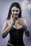 Sensual brunette dressed in black lingerie Stock Image