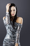Sensual brunette with fashion silver dress Royalty Free Stock Photography