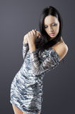 Sensual brunette with fashion silver dress and wot Royalty Free Stock Photography