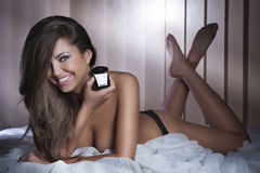 Sensual brunette girl lying, looking at camera. Royalty Free Stock Photo