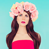 Sensual brunette lady with floral wreath on her head. Roses, Spring, Romance Royalty Free Stock Image