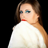 Sensual brunette model with naked back in winter fur Royalty Free Stock Photo
