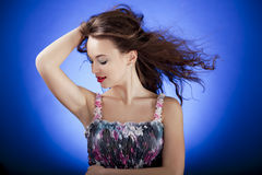Sensual brunette model posing against a blue background Royalty Free Stock Photo