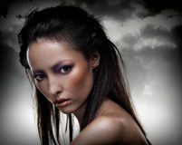 Sensual brunette with multicolored makeup Royalty Free Stock Photo