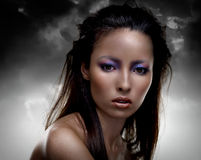 Sensual brunette with multicolored makeup Royalty Free Stock Photos