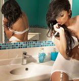 Sensual brunette posing in bathroom. Royalty Free Stock Image
