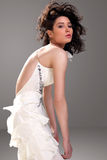Sensual brunette in white dress posing Royalty Free Stock Photos