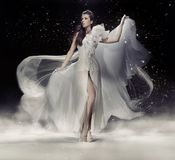 Sensual brunette woman. Dancing in white dress Royalty Free Stock Photo