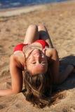 Sensual brunette woman on beach royalty free stock photos