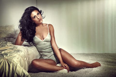 Sensual brunette woman in bedroom Stock Photography