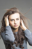 Sensual Brunette Woman With Fly Away Hair Stock Image