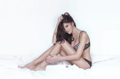 Sensual brunette woman in lingerie. Royalty Free Stock Photography
